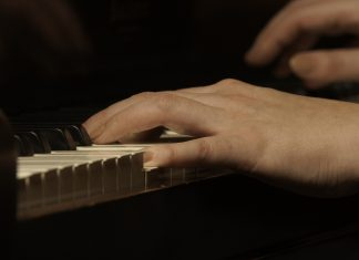 The hands of poet & musician, Jill Niebuhr, aka, Jammin, The Warrior from St. Peter, MN