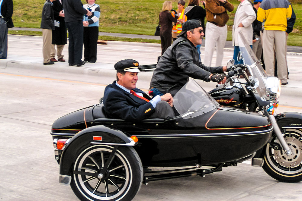 Photo by Rick Pepper - Gil Gutknecht rides is a sidecar across the bridge.