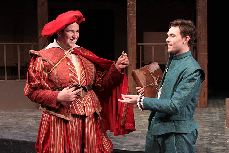 "Photo courtesy Minnesota State University, Mankato Department of Theatre & Dance - The famous actor Richard Burbage (Colin Nord) pays budding playwright William Shakespeare (Ryan Joseph Feist) two sovereigns for his latest play, ""Romeo."""