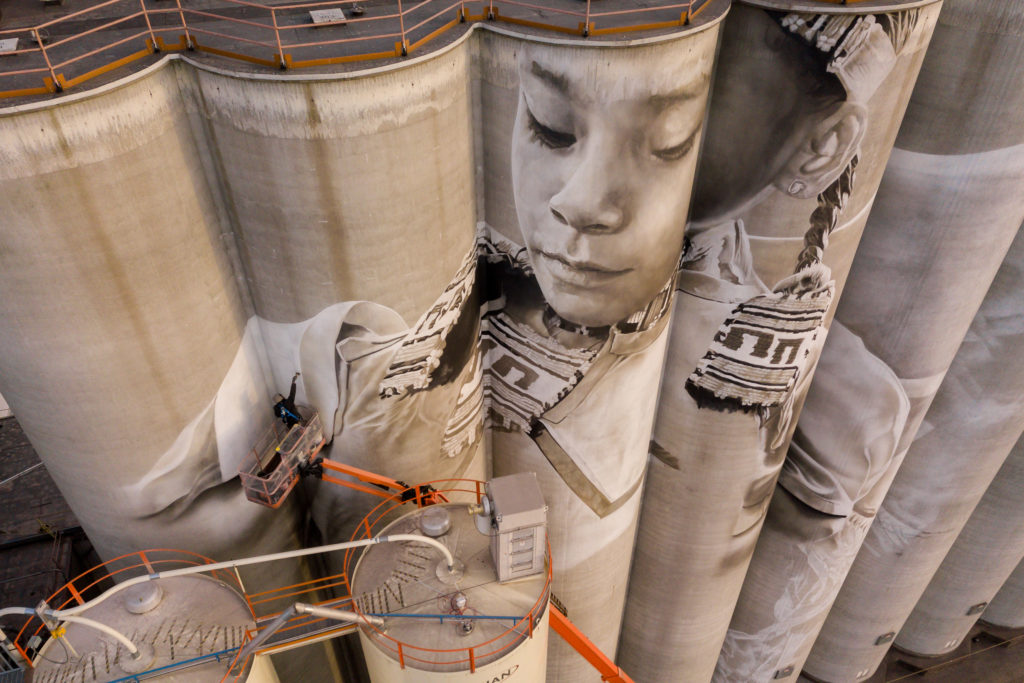 Photo by Rick Pepper - Aerial view Australian artist, Guido van Helten at work on the Ardent Mill grain silos.