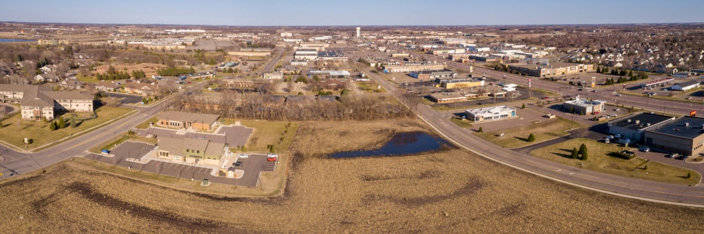 Photo by Rick Pepper - Aerial view looking east while hovering over Madison East Mall. Adams Street is on the left, Tullamore on the right.