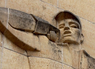Photo by Mike Lagerquist - Detail of the Lineman on the Consolidated Communications building in Mankato
