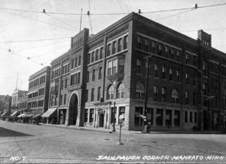 Photo courtesy Maud Hart Lovelace's Deep Valley by Julie A. Schrader - The Saulpaugh Hotel was located where the City Center Hotel sits today. This photograph shows the main entrance to the hotel as it faces South Front Street with Main Street in the foreground, circa 1925. Originally there was an entrance on the Union Depot and Minnesota River side of the hotel. At that time most patrons arrived by steamboat or railroad. The image was taken from approximately where the south entrance of the Blue Earth County Library sits today. The current City Center Hotel ramp sits where South Front Street met Main Street.