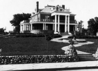 "Submitted Photo - Schmidt Mansion, Mankato - It's an interesting coincidence that the Marsh family home was located on top of a hill behind a slough (now the current West High School). Lovelace describes her house in Emily of Deep Valley as ""a little house huddled against a low hill. It was old and weather-beaten"" and had a ""faded white picket fence."" The Marsh house was torn down in 1923 and an elegant house was built on the property by Oscar and Katherine Schmidt. The Schmidt Mansion remained in the family until 1958, when the YMCA acquired it for office space. The house was torn down in 1988 to make room for a new facility."