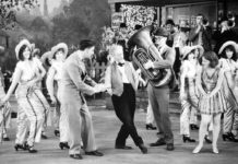 "Photo courtesy Muriel Kuebler Berndt - Muriel and Barbara Kuebler in ""50 Miles from Broadway,"" one of the ""short"" pictures produced by Pathe Films to run in theaters between newsreels and the main feature. Barbara is third from the left and Muriel is to the immediate right of the tuba player."