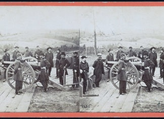 Photo from the Library of Congress - General William T. Sherman, center, leaning on the breach of a cannon, with his staff at Federal Fort No. 7 near Atlanta, Georgia in this stereopticon slide.