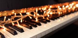 Christmas lights on a classical piano keyboard