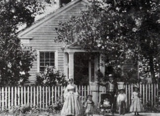 Photo Courtesy of Blue Earth County Historical Society - Home of Parsons King and Laura Johnson family in 1865. The house was built in 1854. L-R: Laura, Frank, Clarence, Parsons King, Charles and Julia.