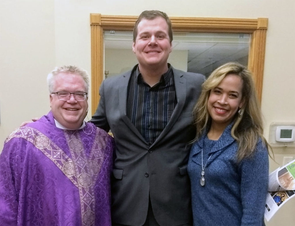 Submitted Image – Father Tim Biren, Garrett Steinberg and his wife, Ana, in St. Charles, March 2020.